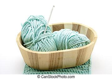 Crochet wool in wooden bowl