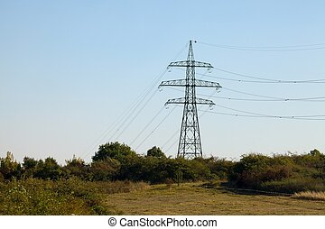 Electric line - High voltage electricity tower on a hill