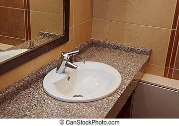 Washroom - Tap and washing basin of a public bathroom