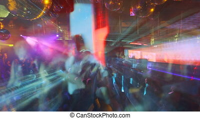 large crowd filling up the dancefloor and dancing at london nightclub