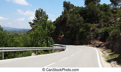 view from a car in the monserrat mountains, spain