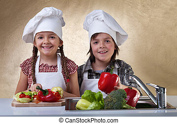 Happy kids washing vegetables for a salad