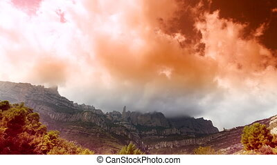 Timelapse of the famous and majestic montserrat mountains in catalonia, near barcelona, spain (amazing clouds and COLOUR ENHANCED using an HDR technique)