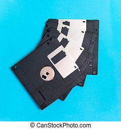 floppy disk magnetic computer data storage support on a blue background