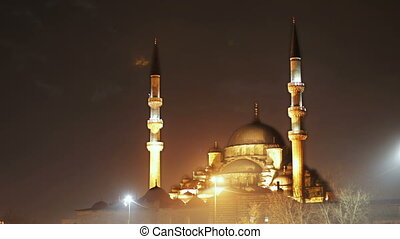the yeni cami mosque in istanbul, turkey at night