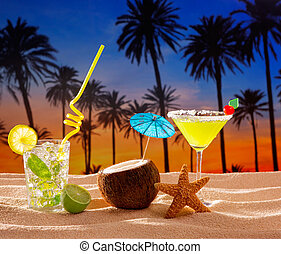 beach cocktail sunset on palm tree sand mojito margarita