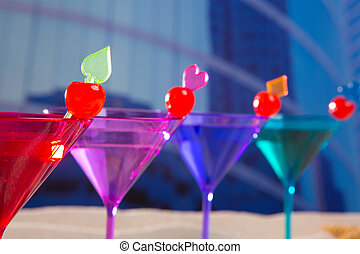 colorful cocktail in a row with cherry sand in urban city