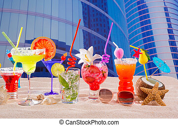 Colorful tropical cocktails in summer at city buildings