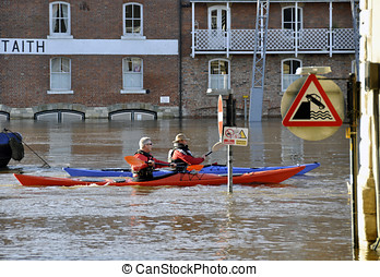 Canoeists on flooded River Ouse