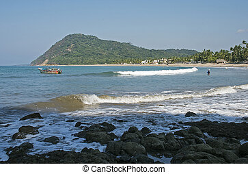 Gentle surf rolling to beach in Lo de Marco, Nayarit, Mexico