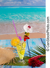 Lemon lime cocktail mojito on tropical beach - Lemon lime...