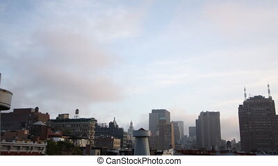 clouds moving across the sky from a new york rooftop