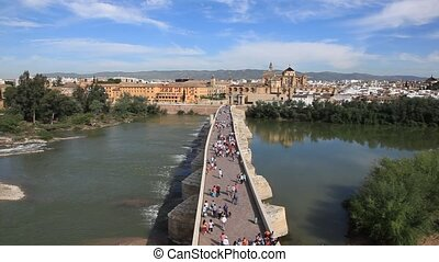 Old bridge in Cordoba, Spain - Ancient bridge and the old...