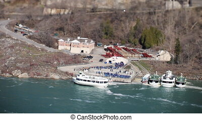 tourists boats at niagara falls, usa and canada
