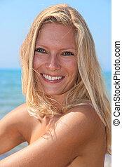 woman on the beach - Beautiful young woman in bikini on the...