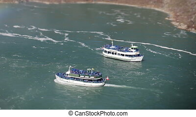 tourist boats in niagara falls, usa and canada