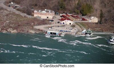 tourist boats at niagara falls, usa and canada