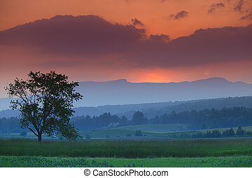Sunset over Mt. Mansfield in Stowe Vermont - Colorful sunset...