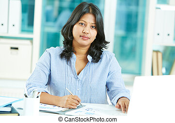 Working in office - Portrait of mature businesswoman looking...