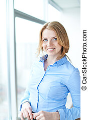 Business lady - Portrait of lovely girl looking at camera...
