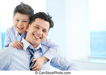 Best friends - Photo of happy boy embracing his dad and both...