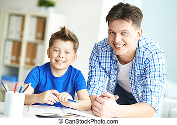 Parent and child - Photo of happy man and his son looking at...