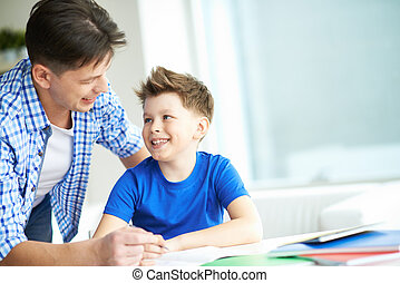 Talking to son - Photo of happy man looking at his son while...