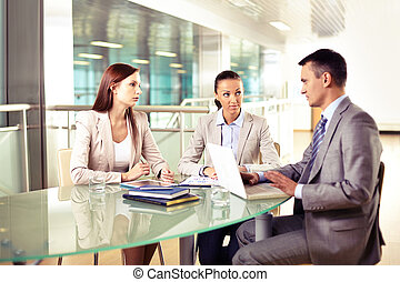 Business interaction - Group of three business partners...