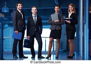 Business partners - Group of friendly businesspeople in...