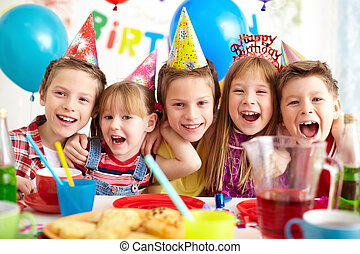 Birthday joy - Group of adorable kids having birthday party