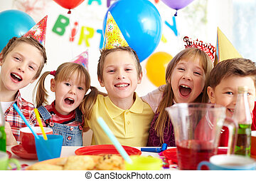 Birthday fun - Group of adorable kids having fun at birthday...