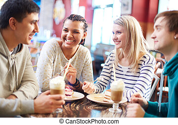 Friends in cafe - Image of teenage friends chatting while...