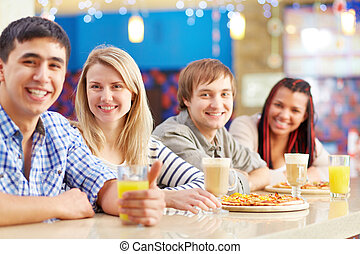 Good time - Image of four teenage friends sitting in cafe