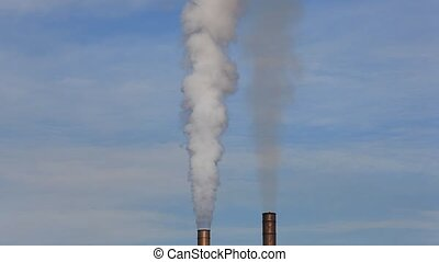 Factory smokestacks blowing fumes into the atmosphere
