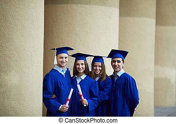 Row of graduates - Group of smart students in graduation...