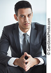 White collar worker - Calm businessman in suit looking at...
