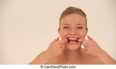 Woman grimacing for camera Close-up
