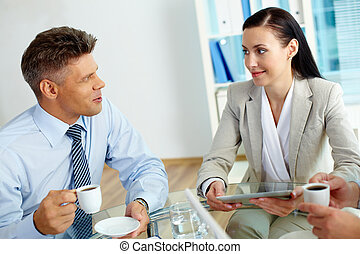 Business discussion - Positive business partners discussing...