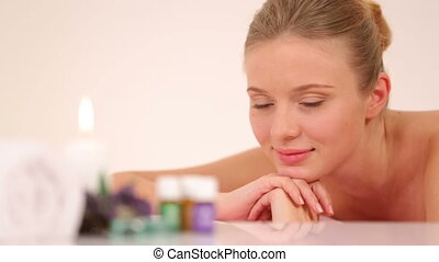 Aroma therapy - Woman relaxing during aroma therapy....