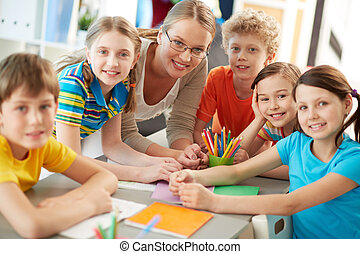 Friendly company - Portrait of diligent schoolkids and...