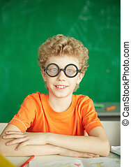 Diligent learner - Portrait of happy schoolboy in eyeglasses...