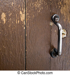 Door Handle and Lock - Brown Wooded Door Segment with Metal...