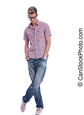 casual man looks down - full length picture of a casual...