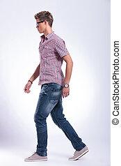 casual man walking forward