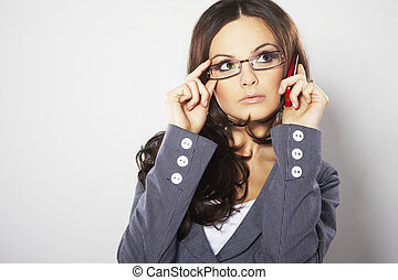 Attractive businesswoman with cell phone and eye glasses