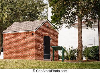 Red Brick Building with Black Door