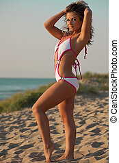 Woman in bathing suit at the beach
