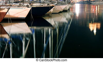 timelapse of the vieux port, marseille with reflection from...