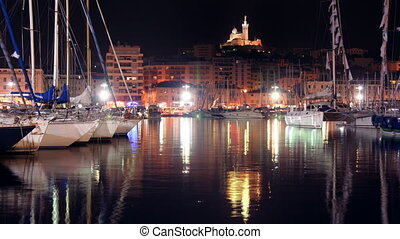 timelapse of the vieux port, marseille with notre dame de la...