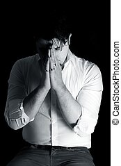 Male praying in black and white